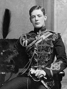 Young Winston Churchill posing in his military dress uniform.