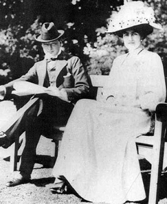 Churchill seated outside next his wife Clementine