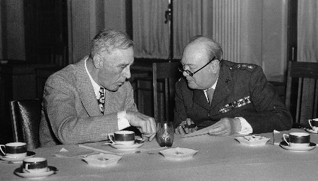 A photograph of Winston Churchill sitting with Franklin D. Roosevelt at the Yalta Conference