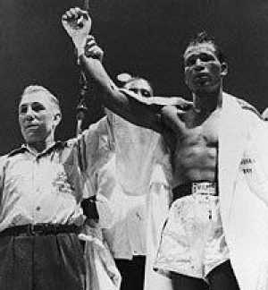 """Brother Robinson is declared the winner of the Feb. 14, 1951 """"Valentine's Day Massacre"""" middleweight championship bout against Jake LaMotta."""