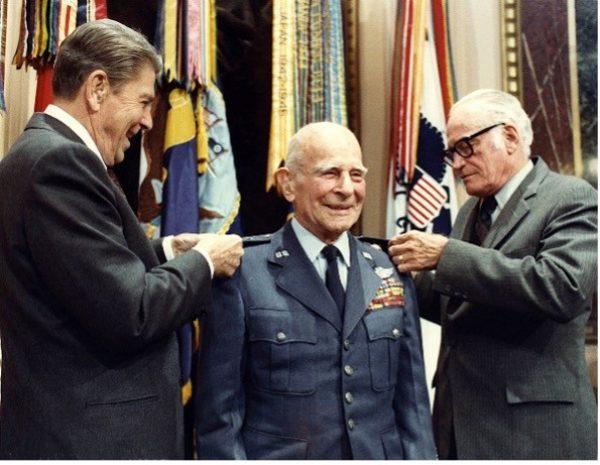 A photo of President Reagan awarding Doolittle a fourth star
