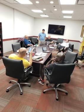 Men at a Freemasonry study session
