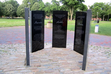 A photograph of the five stone tablets making up the Prince Hall Freemasonry monument in Cambridge, MA