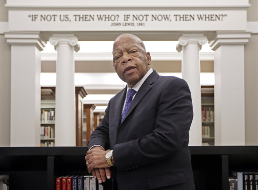 John Lewis poses for a photo under a quote of his that is displayed in the Civil Rights Room in the Nashville Public Library.