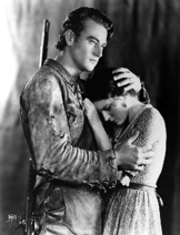 A shot of John Wayne and actress Marguerite Churchill in The Big Trail; John Wayne's first role as a leading man.