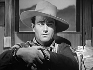 : A shot of John Wayne from his breakout role in the film Stagecoach