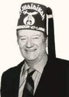 A photograph of John Wayne in his Shriner's cap