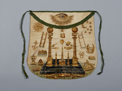 """A Masonic Apron featuring the letter """"G"""""""