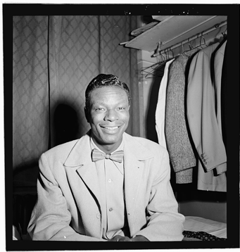 A photograph of Nat King Cole in 1946 at the Paramount Theater in New York City.