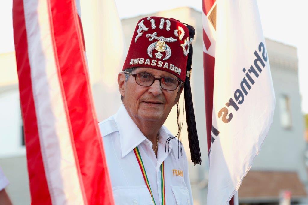 Frank Martinez wearing a Shriners Ambassadors cap