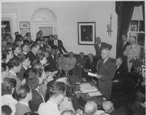 A photograph of President Truman announcing Japan's surrender.