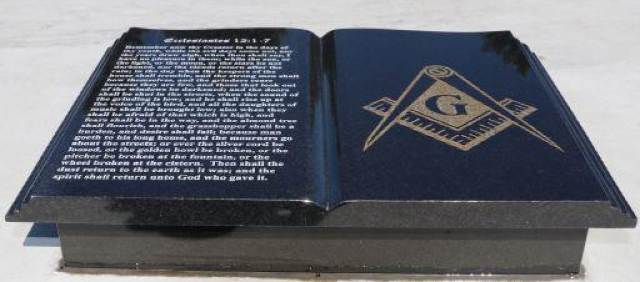 Book with Masonic square and compasses