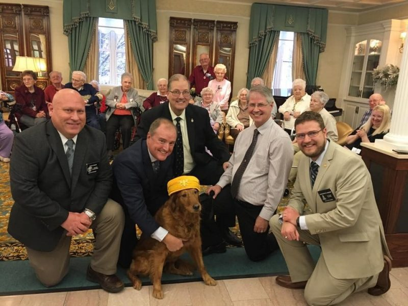 The Valley of Detroit with Shelby the therapy dog, at the Michigan Masonic Home