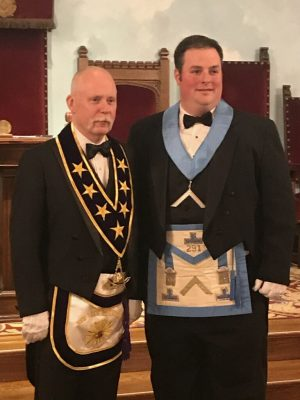 Brother Robert Moore and the current Right Worshipful Grand Master of his lodge.
