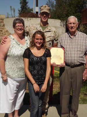 Brother Flowers and his family at his military promotion ceremony
