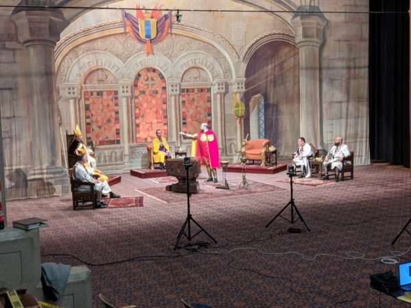 Scottish Rite Masons act out a scene on a temple set