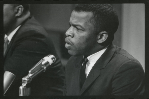 A black and white photo of John Lewis speaking at a meeting of American Society of Newspapers, 1964.