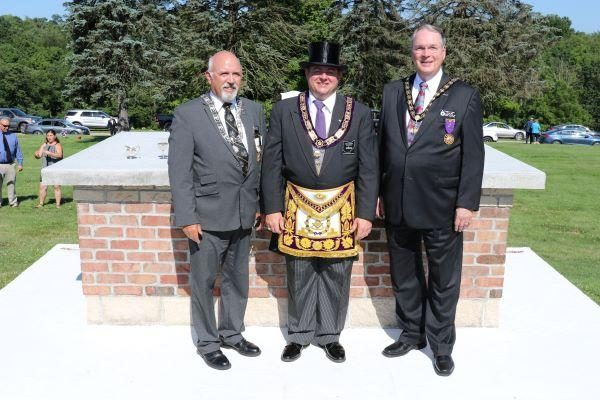 Edsel Emery, deputy representative for the Valley of Steubenville, Masons of Ohio Grand Master Jess Raines, and Douglas Kaylor, Deputy for Ohio